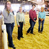 "Don Knight | The Herald Bulletin<br /> To break a tie competitors answered the question ""How would you convince a new family moving into your area to join 4-H and show animals?"" during the Madison County 4-H Fair on Thursday."