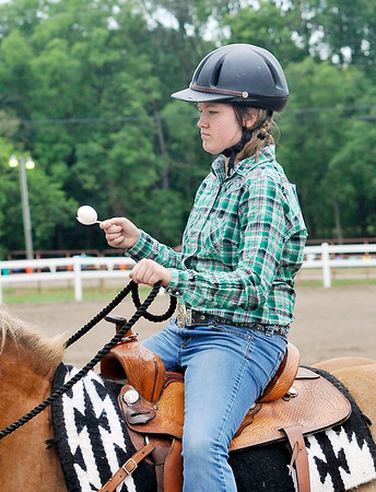 John P. Cleary | The Herald Bulletin Shelby Brown keeps a steady hand as she competes in the Jr/Sr. Egg Race-56 inches and under class at the 4-H Horse & Pony Show Friday.