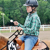 John P. Cleary | The Herald Bulletin<br /> Shelby Brown keeps a steady hand as she competes in the Jr/Sr. Egg Race-56 inches and under class at the 4-H Horse & Pony Show Friday.