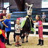 John P. Cleary | The Herald Bulletin<br /> This team cheers for their costumed llama during the 4-H Llama/Alpaca Fun Show Friday at the 4-H Fair.