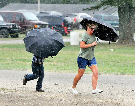 John P. Cleary | The Herald Bulletin Periodic heavy rains  made people run for cover throughout the day during the 4-H Horse & Pony Show Friday at Alexandria.