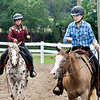 John P. Cleary | The Herald Bulletin<br /> Maria Wood and Clara Spooner give each other room as they compete in the Jr/Sr. Egg Race-56 inches and under class at the 4-H Horse & Pony Show Friday.