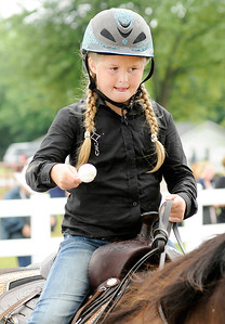 Don Knight | The Herald Bulletin Genna Bradnick competes in the junior egg race during the Horse and Pony show at the 4-H Fair on Saturday. Competitors balance an egg on a spoon while riding their horse and are eliminated if they drop their egg.