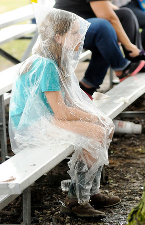 Don Knight | The Herald Bulletin<br /> Laekin Stolle, 10, uses a poncho to keep dry during the Horse and Pony show at the 4-H Fair on Saturday.