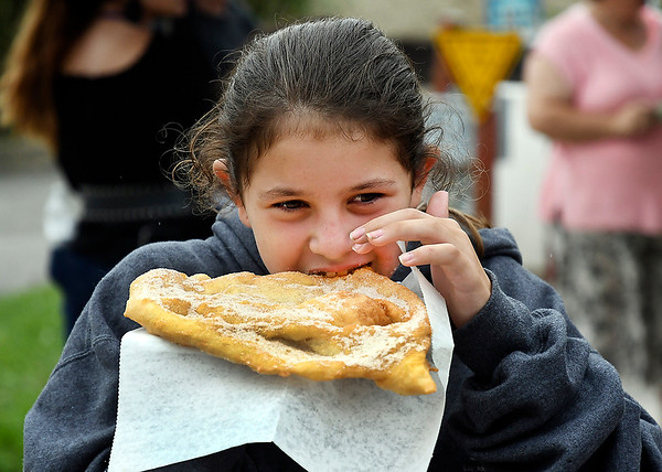 John P. Cleary | The Herald Bulletin<br /> Alexa Quimby, 11, of Frankton, gets her first bite of a 4-H Fair Elephant Ear Monday at the Madison County 4-H Fair.