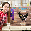 "THB photo | Brooke Kemp<br /> Emma Harvey, 13, shows her winning poster titled ""How Egg-actly,"" which outlines how chickens lay eggs Monday at the Madison County 4-H Fair. Harvey's poster was awarded first place, grand champion, and is going on the the state fair."