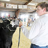 Don Knight | The Herald Bulletin<br /> Miller Smith keeps an eye on the judge during the beef  portion of the Supreme Showmanship contest at the 4-H Fair on Thursday.