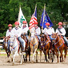 "Don Knight | The Herald Bulletin<br /> The color guard rides around the horse arena as Dolly Partons' ""Color Me America"" plays during the 4-H Fair on Friday."