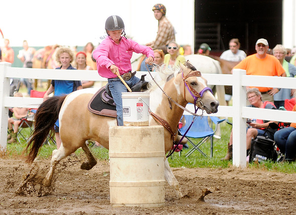 Don Knight | The Herald Bulletin<br /> Brady Shaw on Mama's Precious Angel places first in junior flags 56 inches and under with a time of 9.619 during the 4-H Fair on Friday. Shaw also took home second place riding Speedy.