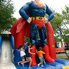 Kids enjoy the inflatables at the Lapel Village Fair.