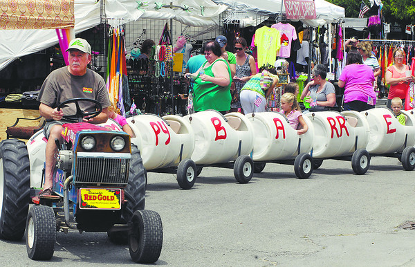 Kids got the chance to take a ride up and down the Lapel Village Fair in the bumpy barrel train.