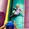 Oliva Ricci, 2, comes down the slide as dad takes her picture at the Lapel Village Fair.