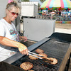 Lois Skinner, of Rocks Concessions of Gas City, Ind., works the hot grill Monday afternoon as the temperatures reached the mid 90s at the 4-H Fair.