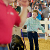 Jessica Greene keeps her pig in line toward the judge during the 4-H Swine Show Monday.