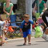 Youngsters pick up candy at the 4-H Parade.