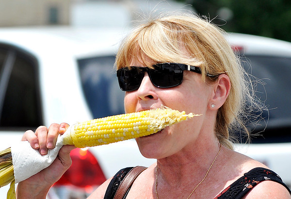 John P. Cleary |  The Herald Bulletin<br /> Glinda Ice, of Alexandria, enjoys an ear of sweet corn Monday at the Madison County 4-H Fair.