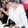 Don Knight | The Herald Bulletin<br /> Alexis Hickman holds a ewe during the Supreme Showmanship contest at the Madison County 4-H Fair on Thursday. Contestants are given an animal at random that they haven't had any experience handling before.