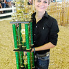Don Knight | The Herald Bulletin<br /> Savannah Martin holds her Supreme Showmanship trophy after winning it during the Madison County 4-H Fair on Thursday.