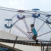 Don Knight | The Herald Bulletin<br /> A child runs across a rope bridge on a midway attraction during the 4-H Fair on Wednesday.