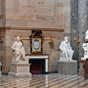 Inside the US Capitol Statuary Hall, the figure sitting to the right of the fireplace is Brigham Young.