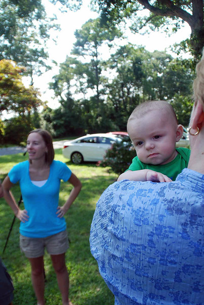 Jean Finkleman holding Parker as his mother Lisa Main looks on.