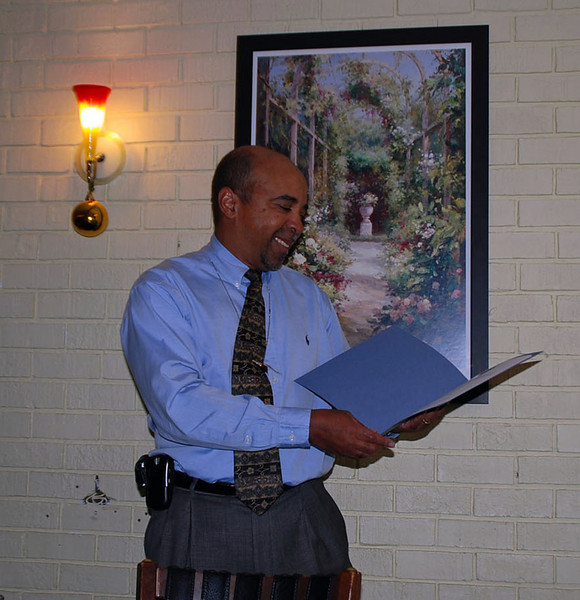 Skip Baylor reading Jean's retirement certificate from County Executive Isiah Leggett.
