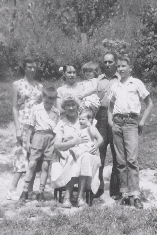 The family of Logan and Pearl Smith, circa 1950s. Pearl's children here are Dorothy (left), Betty Sue (my mother, holding Barbara) and Roger (right). The three younger children are probably Michael, Barbara, and Nancy, Dorothy's kids.