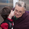 Logan kissing Grandpa John