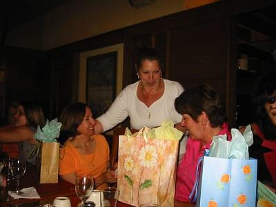 Maritza distibutes gifts. Maria and Joann