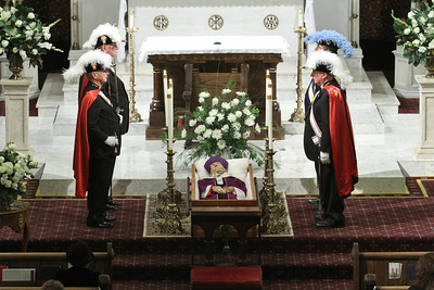 A four-man honor guard of Knights of Columbus and Knights of Peter Claver changed out every 15 minutes as the body of Archbishop John F. Donoghue lay in state at the day before the Nov. 17 funeral Mass.