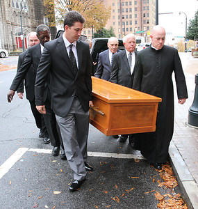 Pallbearers carry the body of Archbishop John F. Donoghue into Sacred Heart of Jesus Basilica, Atlanta, where it lay in state the day before the Nov. 17 funeral Mass.