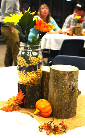Debbie Blank | The Herald-Tribune<br /> A colorful autumn centerpiece and snacks greeted guests when they arrived at tables before dinner.