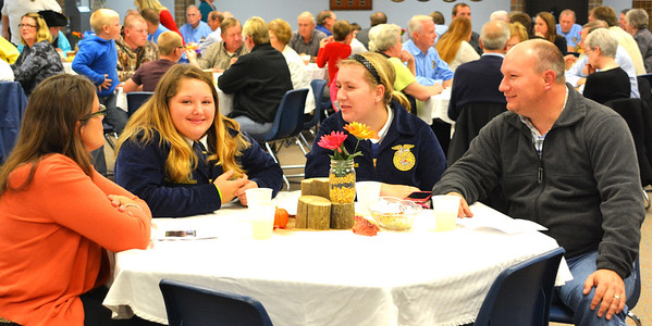 Debbie Blank | The Herald-Tribune<br /> Willie Ronnebaum (from left) and freshman daughter Sarah and sophomore Kaitlynn with dad Greg Ronnebaum were eager to attend their first banquet to view FFA involvement. Willie and Greg are cousins-in-law.