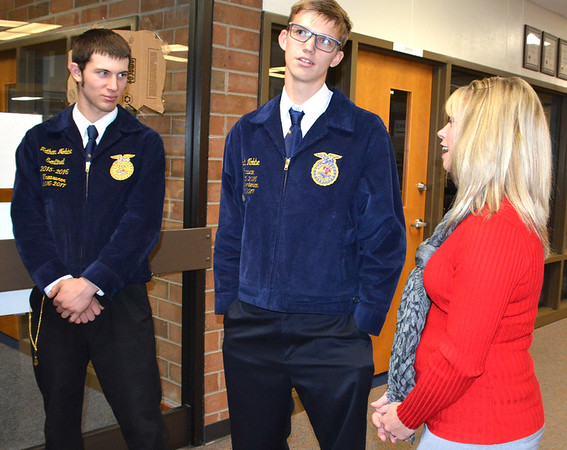 Debbie Blank | The Herald-Tribune<br /> FFA Treasurer Nathan Nobbe (from left), Parliamentarian Josh Nobbe and adviser Cassie Wallpe greeted many of the 108 guests.