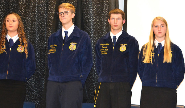 Debbie Blank | The Herald-Tribune<br /> Batesville High School FFA officers, including (from left) Student Adviser Mikayla Redmon, Parliamentarian Josh Nobbe, Treasurer Nathan Nobbe and Secretary Jessica Raver, conducted a business meeting between the dinner and speakers to acquaint attendees with the organization.