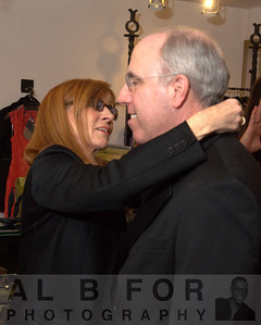 Nicole Miller putting the tie on Stephen Spinelli Jr., Ph.D.,(President of Philadelphia University)