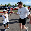 "James Knapp has a high five for his son, Justin, 8, after the pair finished the 1K Fun Run as part of the Fathers' Day activities at the Boulder Reservoir on Sunday.<br /> For more photos of the races, go to  <a href=""http://www.dailycamera.com"">http://www.dailycamera.com</a>. or  <a href=""http://www.timescall.com"">http://www.timescall.com</a>.<br /> Cliff Grassmick / June 17, 2012"