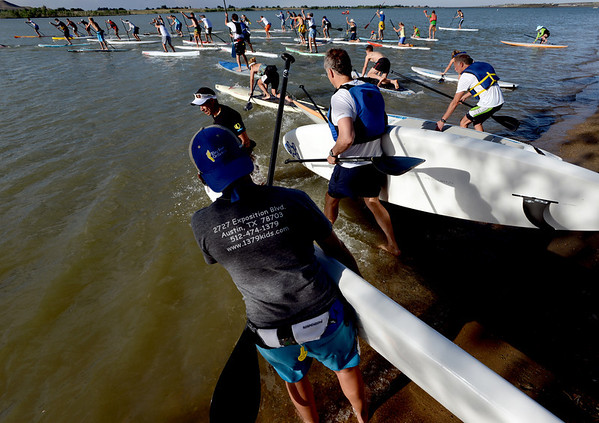 "Racers begin the 1-mile paddleboard race as part of the Father's Day activities at the Boulder Reservoir on Sunday.<br /> For more photos of the races, go to  <a href=""http://www.dailycamera.com"">http://www.dailycamera.com</a>. or  <a href=""http://www.timescall.com"">http://www.timescall.com</a>.<br /> Cliff Grassmick / June 17, 2012"