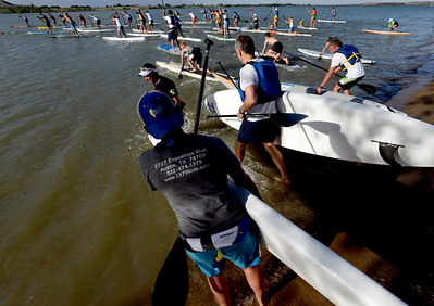Racers begin the 1-mile paddleboard race as part of the Father's Day activities at the Boulder Reservoir on Sunday. For more photos of the races, go to www.dailycamera.com. or www.timescall.com. Cliff Grassmick / June 17, 2012