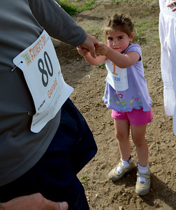 Gwyneth Stasko, 3, pulls on her dad, Gerald, because she is ready to go home after the 1K Fun Run. For more photos of the races, go to www.dailycamera.com. or www.timescall.com. Cliff Grassmick / June 17, 2012