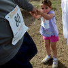 "Gwyneth Stasko, 3, pulls on her dad, Gerald, because she is ready to go home after the 1K Fun Run.<br /> For more photos of the races, go to  <a href=""http://www.dailycamera.com"">http://www.dailycamera.com</a>. or  <a href=""http://www.timescall.com"">http://www.timescall.com</a>.<br /> Cliff Grassmick / June 17, 2012"