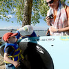 "R.L Smith has a kiss for his  his son, Spencer, 4, after finishing the Fathers' Day paddleboard race at the Boulder Reservoir. Spencer's mom, Tricia Vieth, is on the  right.<br /> For more photos of the races, go to  <a href=""http://www.dailycamera.com"">http://www.dailycamera.com</a>. or  <a href=""http://www.timescall.com"">http://www.timescall.com</a>.<br /> Cliff Grassmick / June 17, 2012"