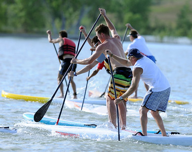 Racers compete in the 1-mile paddleboard race as part of the Father's Day activities at the Boulder Reservoir on Sunday. For more photos of the races, go to www.dailycamera.com. or www.timescall.com. Cliff Grassmick / June 17, 2012
