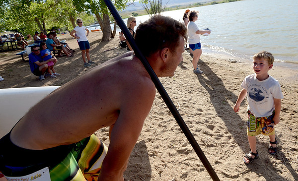 "Ash Elliot, right, talks to his dad, Sean, after his dad finished second in the paddleboard race on Sunday.<br /> For more photos of the races, go to  <a href=""http://www.dailycamera.com"">http://www.dailycamera.com</a>. or  <a href=""http://www.timescall.com"">http://www.timescall.com</a>.<br /> Cliff Grassmick / June 17, 2012"