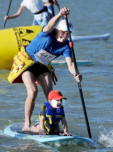 R.L Smith and his son, Spencer, 4, show the intensity in their face as they are about to finish the 1-mile paddleboard race at the Boulder Reservoir on Sunday. The race was part of a group of Fathers' Day events. For more photos of the races, go to www.dailycamera.com. or www.timescall.com. Cliff Grassmick / June 17, 2012