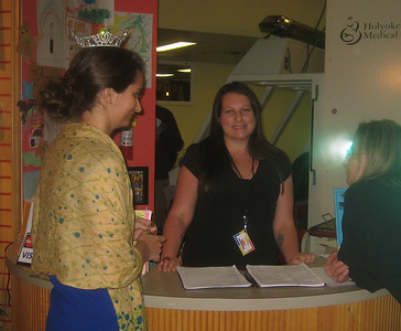 Miss Holyoke 2011 (left), Children's Museum staff member Sarah Thompson and Director marypaz (right)  at the front desk.