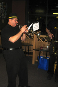 Ed on trumpet and Ken (right edge of picture) with a baritone horn. The Expandable Brass Band.