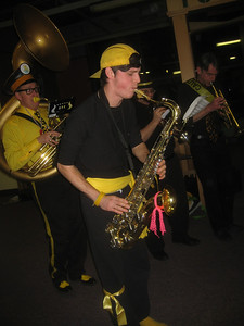 The Expandable Brass Band plays on:  Cooper on saxophone, Fred on trumpet, and  Dr. Yes on sousaphone.