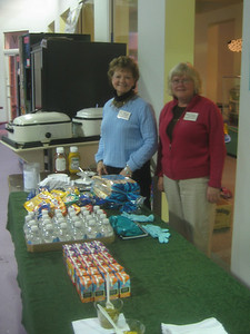 Children's Museum board members ready to serve the kid-friendly food (hot dogs and fixings).