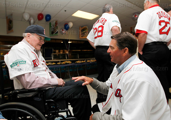 BOSTON -- Former Boston Red Sox pitcher Bruce Hurst, second from right, talks with a fellow Red Sox alumnus at Fenway High School prior to the special pregame ceremony celebrating the 100th anniversary of Fenway Park on Friday, April 20, 2012. (Brita Meng Outzen/Boston Red Sox)